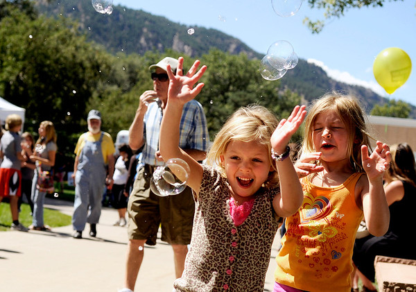 "Gabrielle Keidan, 5, at left, and her sister Sarah Keidan, 6, play with bubbles on Saturday, Sept. 3, during the Boulder Creek Hometown Fair in Boulder. For more photos and video of the fair go to  <a href=""http://www.dailycamera.com"">http://www.dailycamera.com</a><br /> Jeremy Papasso/ Camera"