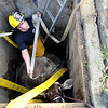 "Mountain View firefighter Ben Carter works to rescue a cow that fell into a well on Friday, Oct. 7, at 12166 Jay Rd. in Erie. For more photos and video of the rescue go to  <a href=""http://www.dailycamera.com"">http://www.dailycamera.com</a><br /> Jeremy Papasso/ Camera"