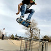 David Biddle, 23, of Boulder, throws a kick flip over a shopping cart on Sunday, March 20, at the Boulder Skate Park at Scott Carpenter Park in Boulder.<br /> Jeremy Papasso/ Camera
