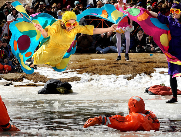 """Tracy Piniarczyk, 32, of Boulder, left, plunges into the frozen lake belly first during the Polar Plunge on Saturday, March 5, during """"Frozen Dead Guy Days"""" in Nederland. For more photos and video go to  <a href=""""http://www.dailycamera.com"""">http://www.dailycamera.com</a><br /> Jeremy Papasso/ Camera"""