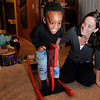 "Suzanne Schmidt and her two-year-old son Gavin laugh while he rocks on his rocking horse on Friday, Jan. 14, at their home in North Boulder. Schmidt adopted Gavin from Haiti and gave him a loving home in Boulder. For a video of the Schmidts go to  <a href=""http://www.dailycamera.com"">http://www.dailycamera.com</a><br /> Photo by Jeremy Papasso"