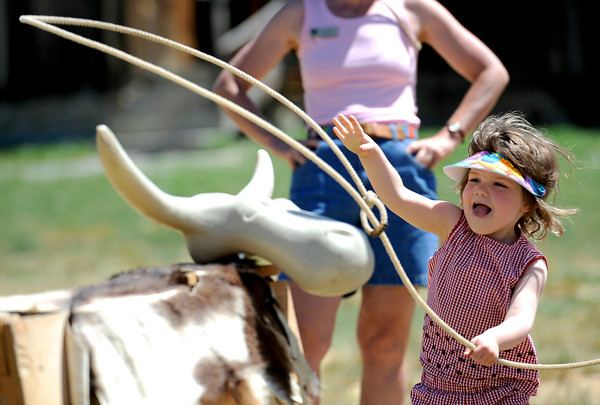 0626CRIT.jpg Loryn Rae Hoffman, 3, tries to lasso a practice steer at Barnyard Critter Day at the Agricultural Heritage Center in Longmont, Colorado June 26, 2011.  CAMERA/Mark Leffingwell