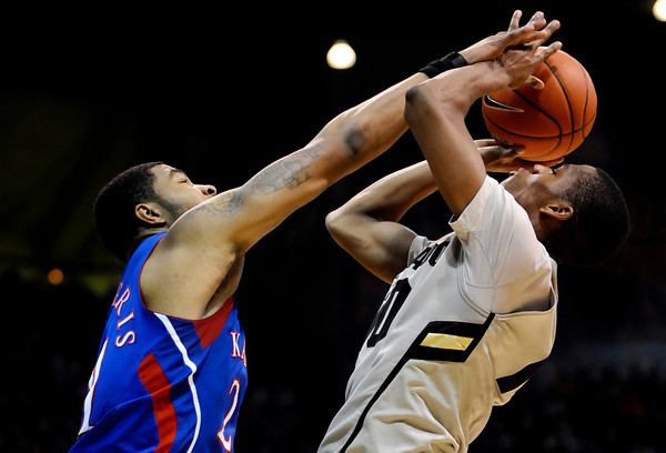 0124CUKU101.jpg Colorado's Alec Burks (right) gets fouled by Kansas' Markieff Morris (left)during their game at the University of Colorado in Boulder, Colorado January 24, 2011.  CAMERA/Mark Leffingwell