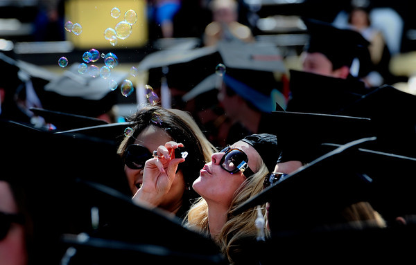 0506GRADML4.jpg Morgan Griffin, graduate in International Affairs, blows bubbles during the commencement ceremony held in Folsom Field at the University of Colorado in Boulder, Colorado May 6, 2011.  CAMERA/Mark Leffingwell