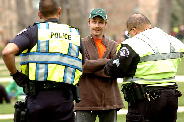 POT2.jpg Michael Lundy of Grand Junction talks to CUPD Officer Josh Trevtler, left and Sgt.  Vinne Monfez of the Boujlder County Sheriff's Department as they give him a ticket for possession of marijuana on Norlin Quad on Wednesday afternoon on the CU Boulder Campus.<br /> Photo by Paul Aiken
