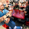 Josh Recibe, left, takes a second to savor his beer on the patio at Avery Brewing Tap Room on Tuesday afternoon. With Recibe from left to right is Craig Monroy, Richard Patrick and Dave Pack. <br /> Photo by Paul Aiken