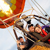 "BALLOON633.JPG Passengers Gene and Anne Schiferl, get their photo taken before their flight with Life Cycle Balloon Adventures in the Gunbarrel area of Boulder on Thursday morning. Passenger Scott Shevlin is seen at left.<br /> FOR MORE PHOTOS AND A VIDEO OF THE LIFTOFF GO TO  <a href=""http://WWW.DAILYCAMERA.COM"">http://WWW.DAILYCAMERA.COM</a> <br /> Photo by Paul Aiken / The Camera / 8/ 18/ 2011"