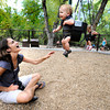 WARM OCTOBER147.JPG Jill Tomb, works to get a smile out of her son Jude, 11 months, as they spend a warm October afternoon in Eben G. Fine Park in Boulder.<br /> Photo by Paul Aiken / October 3, 2001