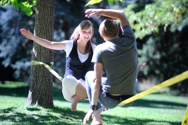 SLACKLINE.jpg Kira Womble, left and Alex Bing laugh as they try to balance on a slackline together on the Norlin Quad on the CU Boulder Campus on Monday afternoon.<br /> Photo by Paul Aiken / The Camera / September 19, 2011