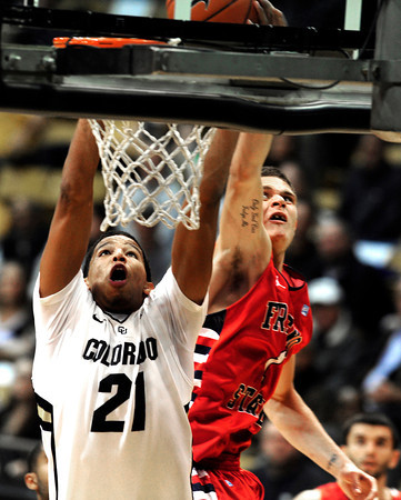 """COBOU1015.JPG Andre Roberson, (21)of the University of Colorado Buffaloes goes to the basket against Tyler Johnson (1) Fresno State Bulldogs during their game in Boulder Colo. on Wednesday December 7, 2011.   Photo by Paul Aiken / The Boulder Camera / December 7, 2011<br /> For more photos go to  <a href=""""http://www.buffzone.com"""">http://www.buffzone.com</a>"""
