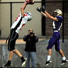 "BOULDERLOVE177.JPG Loveland's Kirk Shaw, 16, makes an interception in front of Boulder's Loic Guegan, 14, during their game at Recht Field at Boulder High School on Friday September 9, 2011. <br /> FOR MORE PHOTOS FROM THE GAME GO TO  <a href=""http://WWW.DAILYCAMERA.COM"">http://WWW.DAILYCAMERA.COM</a><br /> Photo by Paul Aiken / The Camera / September 9 2011"