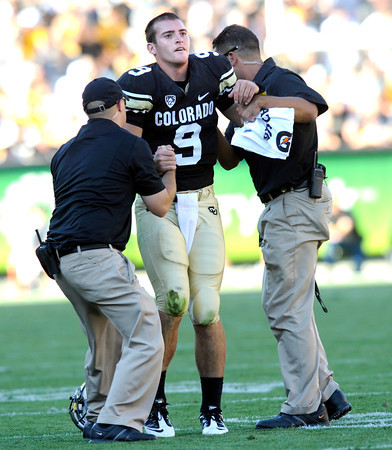 "CUVSCAL201.JPG CU'S Tyler Hansen is helped from the field late in the game at Folsom Field in Boulder.<br /> For more photos of the CU game, go to  <a href=""http://www.dailycamera.com"">http://www.dailycamera.com</a>.<br /> Paul Aiken / September 10, 2011 / The Daily Camera"