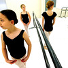 "BALLET20.JPG Austin Price, front left, holds a ready pose as students at Ballet Nouveau Colorado wait to perform a section of dance on Monday December 5, 2011. With Price from left to right are students Anne Soeth, Ashley Miller, and Gracia Vought.  Ballet Nouveau in Broomfield is one of dozens of Boulder and Broomfield county groups that are recipients of the proceeds of Colorado Gives Day. A number of students in the school receive scholarships from the fund. For more photos of the class go to  <a href=""http://www.dailycamera.com"">http://www.dailycamera.com</a><br /> Photo by Paul Aiken / The Camera"