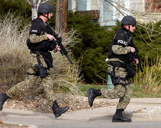"STANDOFF23.JPG SWAT team members close in on a suspect at a standoff at Boulder Community Hospital on Monday April 4, 2011. For more photos and a video of the standoff go to  <a href=""http://www.dailycamera.com"">http://www.dailycamera.com</a><br /> Photo by Paul Aiken"