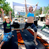 HILLFLEA.jpg Jacob Harris, 3, follows the lead of Shareshten Senior of Corepower Yoga during a demonstration as part of the Hill Flea on University Hill in Boulder on Saturday morning. Ella Lyons, 9, at right of Lyons also participates.<br /> Photo by Paul Aiken / The Camera / 8/ 13/ 11