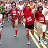 "2011BOLDER858.JPG From left to right Creighton Rauh, Jon Johannsen, Daniel Peacock as the devil and Chris Davis as Jesus during start of the 2011 Bolder Boulder.<br /> For more photos and videos go to  <a href=""http://www.dailycamera.com"">http://www.dailycamera.com</a><br /> Photo by Paul Aiken  / The Boulder Camera"