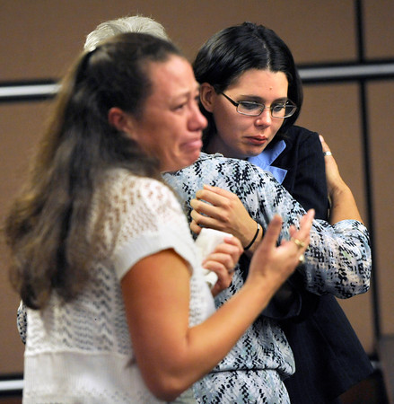 CAMPOS2.jpg Angela Pickering, right, mother of Lyon Campos, is comforted by paralegal Mary Kottenstette as Joaquin Campos' former foster mother Stacee White watches him leave the Boulder County courtroom Thursday morning. A judge sentenced Campos to 20 years in prison for causing the death of his infant son, Lyon.