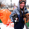 OCCUPY1.jpg Eve Shapiro corrals two puppies that escaped from a tent at the Occupy Boulder site outside the municipal building on Monday afternoon December 19, 2011. <br /> Photo by Paul Aiken Aiken / The Camera