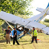 CRASH.jpg Emergency personnel examine the scene of a plane crash just outside Boulder Municipal Airport on Tuesday evening.<br /> Photo by Paul Aiken  August 9, 2011.