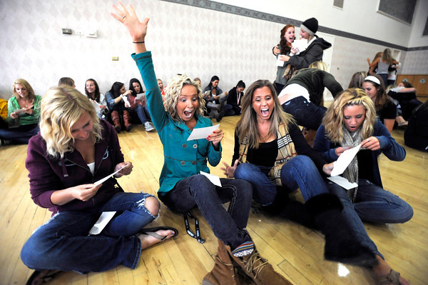 "RUSH10.jpg A group of bidding CU students from left to right Mandie Capozzelli, Cicily Carter, Jacqueline Campangna and Zoe Calvin tear open their envelopes to discover which sorority they will belong too at the Glenn Miller Ballroom on the CU Boulder Campus Wednesdy evening on Sorority Bid Day. FOR MORE PHOTOS AND A VIDEO OF BID DAY GO TO  <a href=""http://WWW.DAILYCAMERA.COM"">http://WWW.DAILYCAMERA.COM</a><br /> Photo by Paul Aiken / The Camera / September 7, 2011"