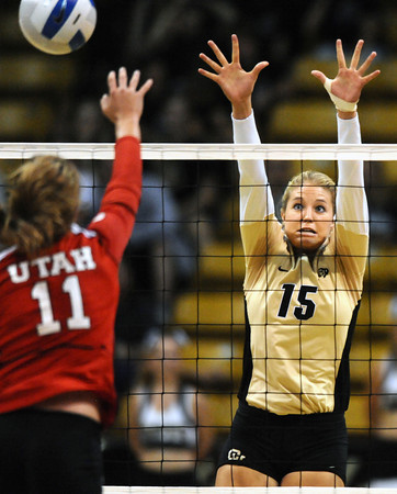 "VOLLEY66.JPG Nikki Lindow, 15, of the University of Colorado goes for a block against Chelsey Schofield, 11, in CU's game against Utah at the Coors Events Center on Tuesday. For more photos from the game go to  <a href=""http://www.buffzone.com"">http://www.buffzone.com</a><br /> Photo by Paul Aiken / The Camera / September 13, 2011"