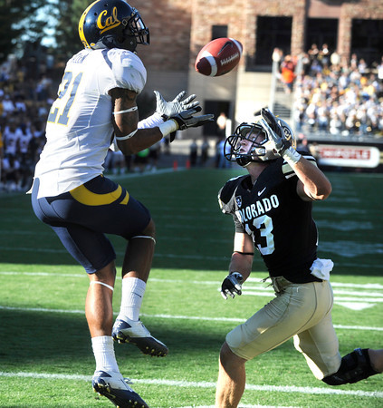 "CUVSCAL190.JPG RESENDING WITH CORRECT SIZING<br /> FIRST TRANSMISSION WAS TOO SMALL<br /> Keenan Allen of Cal catches the winning touchdown over Parker Orms of the University of Colorado in the overtime game in Boulder, Co.<br /> For more photos of the CU game, go to  <a href=""http://www.dailycamera.com"">http://www.dailycamera.com</a>.<br /> Paul Aiken / September 10, 2011 / The Daily Camera"