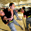 "ROTC169.JPG Cadet Captain Max Perez carries third year Cadet Robert-Josef Heitzer as the Alpha Company, Golden Buffalo Battalion trains very  early Thursday morning on September 8, 2011 in the CU recreation center on the University of Colorado Boulder Campus.<br /> FOR MORE PHOTOS AND A VIDEO OF THE TRAINING GO TO  <a href=""http://WWW.DAILYCAMERA.COM"">http://WWW.DAILYCAMERA.COM</a><br /> Photo by Paul Aiken / The Camera / September 6 2011"