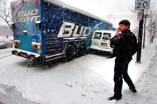 "BUDLIGHT.jpg The driver of a Bud Light truck, who asked not to be identified, talks on his phone after he was involved in a fender bender with a Coors van on Walnut Avenue in downtown Boulder on Wednesday afternoon.<br /> Photo by Paul Aiken / The Camera<br /> For a video of the accident go to  <a href=""http://www.dailycamera.com"">http://www.dailycamera.com</a>"