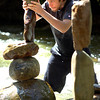 "STONESTACK.jpg Mike Grab carefully adds a stone on top of a precarious piece of stone artwork in Boulder Creek at Eben G. Fine park in Boulder. Grab, who said he was bored one day and just started stacking stones is now addicted to the pursuit. ""I just can't stop doing it."" You can see his photographs of his stone sculptures his web site  <a href=""http://www.gravityglue.com"">http://www.gravityglue.com</a>. Watch a video of Grab creating his sculptures at  <a href=""http://www.dailycamera.com"">http://www.dailycamera.com</a><br /> Photo by Paul Aiken  August 5, 2011."