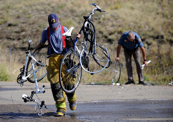 bike.jpg Colin Stenhouse of the Lefthand Fire Department carries away two bikes involved in an accident on North Foothills Highway Thursday morning on September 8, 2011<br /> Photo by Paul Aiken / The Camera / September 8 2011