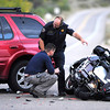 NELSONACCIDENT.jpg Maury Miller, an Investigator with the Coroner's Office, left and Bud Hines with the Colorado State Patrol look over the scene of a fatal motorcycle accident at the intersection of Nelson Road and U.S. 36 north of Boulder on Saturday evening. <br /> Photo by Paul Aiken / October 1, 2001