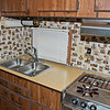 Installed a new updated kitchen faucet. The cook top and oven are going! I'm going to install a new cook top and eliminate the oven and use the space for kitchen storage. Not sure what to do with the vent hood yet.