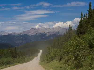 Elevated view of dirt road passing through landscape with mountains in the background, Kananaskis Country, Southern Alberta, Alberta, Canada