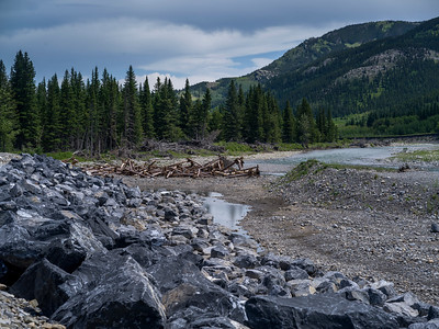 Stones and destructed pier at riverside, Kananaskis Country, Southern Alberta, Alberta, Canada