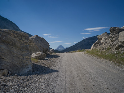 Dirt road passing through mountains, Frank Slide, Kananaskis Country, Southern Alberta, Alberta, Canada
