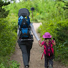Woman with her daughter hiking on trail, Waterton Lakes National Park, Alberta, Canada