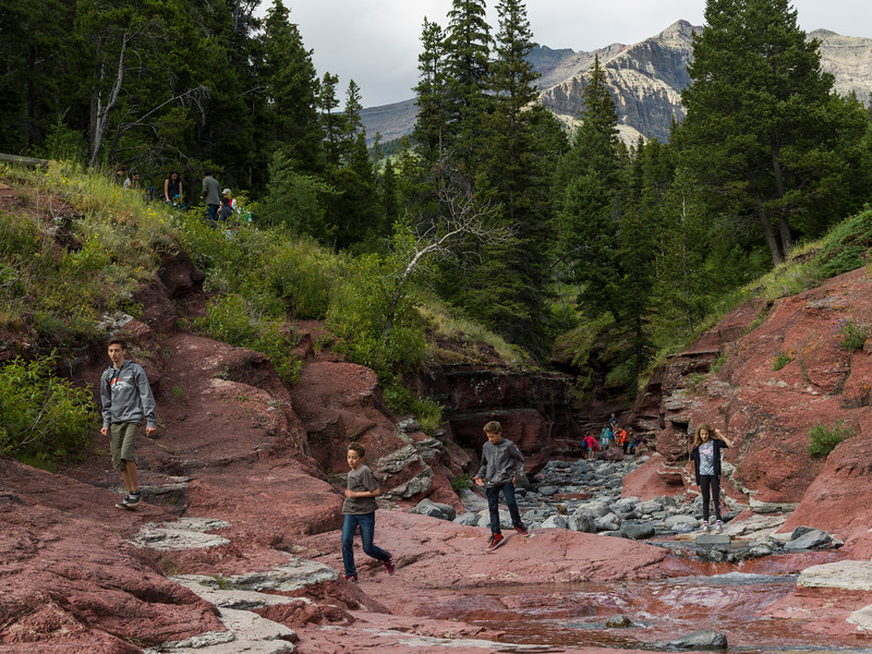 Tourists in canyon, Red Rock Canyon Parkway, Waterton Lakes National Park, Alberta, Canada