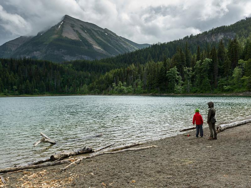 Tourists at lakeshore, Crandell Lake, Waterton Lakes National Park, Alberta, Canada