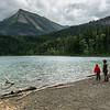 Tourists at lakeshore, Crandell Lake, Waterton Lakes National Park, Alberta, Canada