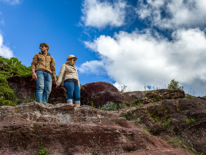 Tourists on the rock, Red Rock Canyon Parkway, Waterton Lakes National Park, Alberta, Canada