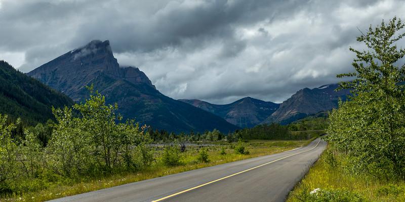 Road leading towards mountain, Red Rock Canyon Parkway, Waterton Lakes National Park, Alberta, Canada