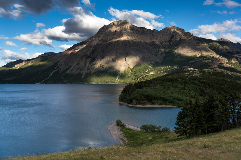 Lake with mountain range in the background, Waterton Park, Alberta, Canada