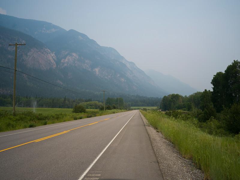 Road passing through field, Golden, British Columbia, Canada