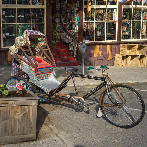 Rickshaw parked outside store, Nelson, British Columbia, Canada