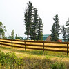 Fence in field, Golden, British Columbia, Canada