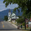 Two women walking at roadside, British Columbia, Canada