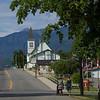 Two women walking at roadside, British Columbia, Canada