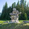 Inukshuk in field, Fernie, British Columbia, Canada