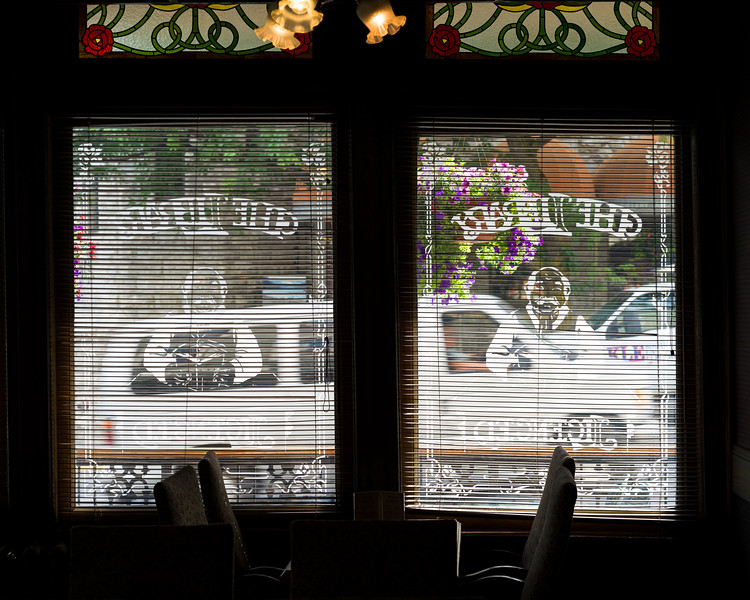 Cars on road seen through the window of building, Nelson, British Columbia, Canada