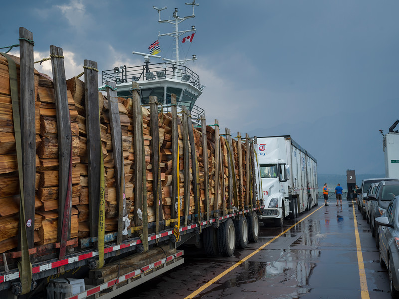 Ferry loaded with trucks and cars in lake, British Columbia, Canada